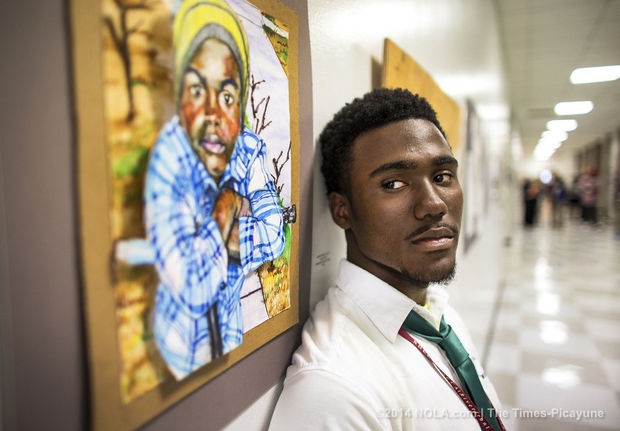 Leonard Galmon, a NOCCA and Cohen College Prep senior who grew up around the C.J. Peete housing projects, will be going to Yale next year. He was photographed near one of his pieces hanging on a hallway wall at the end-of-year art show at NOCCA on Thursday, May 8, 2014. (Photo by Chris Granger, Nola.com   The Times-Picayune)