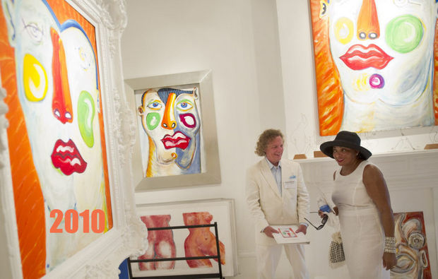 MATTHEW HINTON / THE TIMES-PICAYUNE Artist Steve Martin talks with Gwendolyn Newman-Culp at Martin's studio during White Linen Night, a celebration of the visual arts centered around art galleries on and around Julia Street in the CBD, in New Orleans Saturday August 7, 2010.