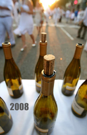 DANNY BOURQUE / THE TIMES-PICAYUNE The 14th Annual White Linen Night takes place along Julia and Camp streets featuring art, drinks, and music on Saturday, August 2, 2008. A gathering of empty wine bottles decorates a table in the middle of Julia Street.