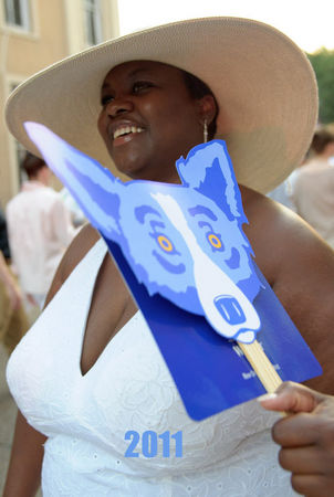 MATTHEW HINTON / THE TIMES-PICAYUNE Shannon Guy from New Orleans keeps cool with a George Rodrigue Blue Dog fan on White Linen Night on Julia Street, Saturday, August 6, 2011 in New Orleans, La.