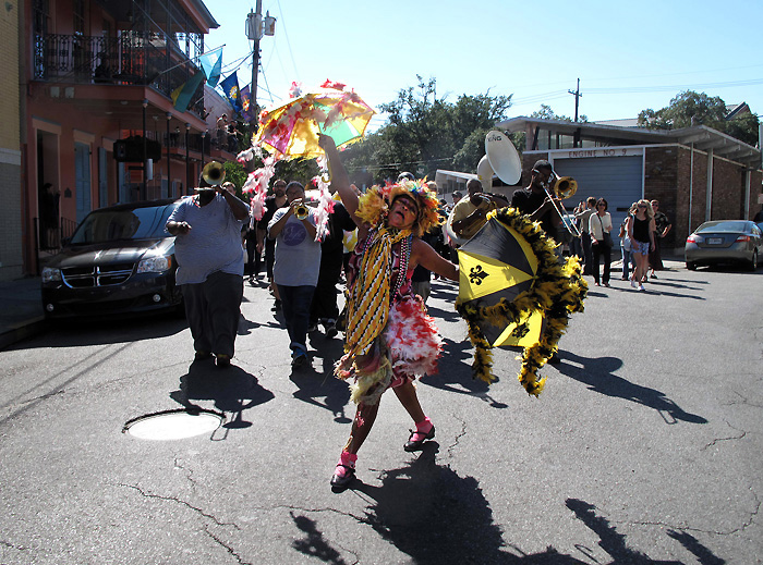 The Grand Marshall leading the Second Line procession through the street of New Orleans