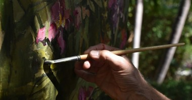 John Alexander uses flowers in the garden at Eaton Fine Art for his new series of paintings.