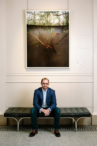 """Russel Lord, a curator at the New Orleans Museum of Art, below Isabelle Hayeur's """"Jean Lafitte 02."""" William Widmer for The New York Times"""