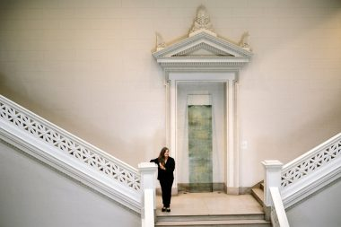 """Dawn DeDeaux stands near her sculpture """"Rushed in Near Ten…"""" at the New Orleans Museum of Art. William Widmer for The New York Times"""