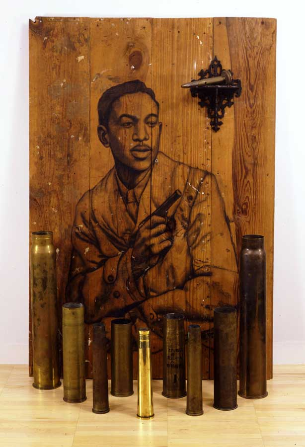 Whitfield Lovell | You're My Thrill, 2004 | Charcoal on wood, bombshell casings | 54 x 36 1/2 x 14 inches