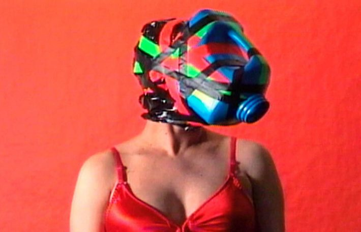 "A video still of Cheryl Donegan's ""Cellar Door,"" from her 2000 series ""The Janice Tapes."" She re-created several masks from the piece for her new show.	Credit Courtesy Electronic Arts Intermix"