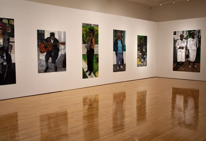 Portraits by Willie Birch line a wall at the Paul and Lulu Hilliard University Art Museum. Photos by Haoua Amadou/The Vermilion